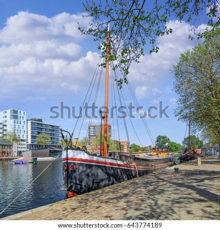 Ancient boat docked at the Piushaven in Tilburg, The Netherlands