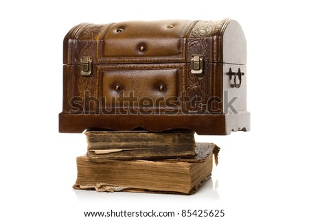 Ancient books and decorative chest on white background