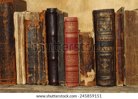 Ancient books on wooden background