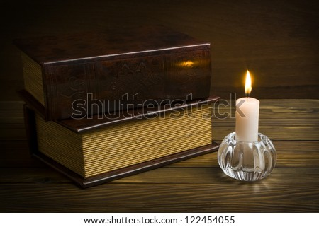 ancient books with candle - stock photo