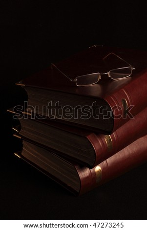 Ancient books with furnish from a skin and metal - stock photo
