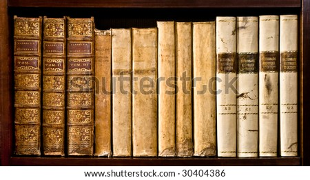 Ancient books (XVI and XVII century) on a wood shelf