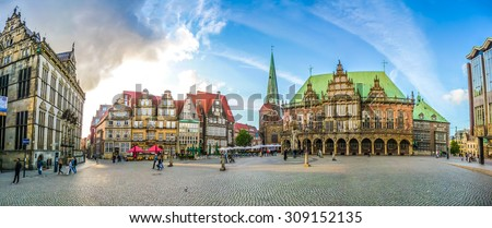 Ancient Bremen Market Square in the centre of the Hanseatic City of Bremen with view on The Schuetting, famous Raths-Buildings, Church of Our Lady, town hall and parliament building, Germany - stock photo