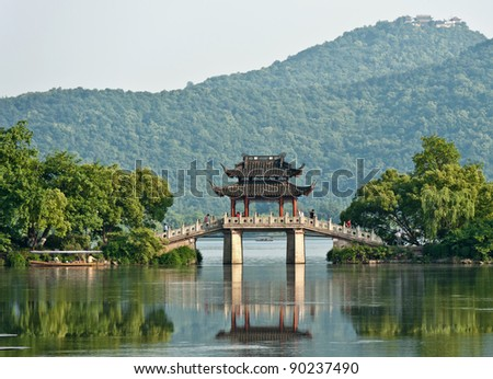 Ancient bridge over a lake, China