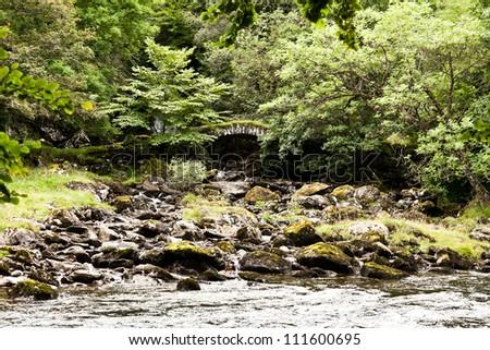 Ancient bridge over river - stock photo