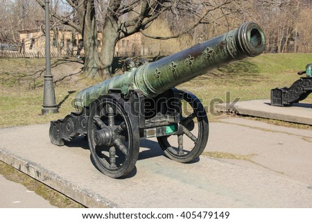 Ancient bronze French cannon 1626 on a wheel gun carriage - stock photo
