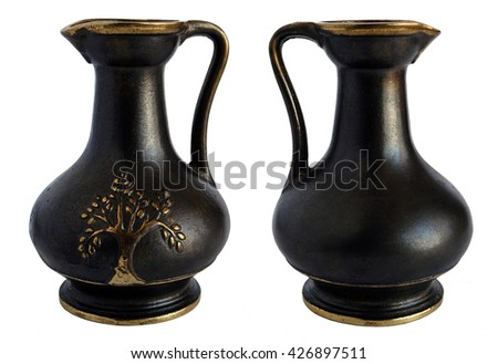 Ancient bronze jug isolated on white background