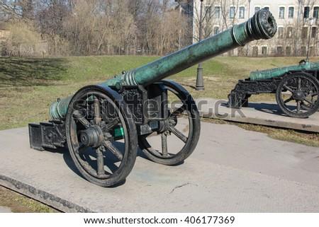 "Ancient bronze Riga-Polish-Lithuanian cannon ""Sentry crane"" cast in Riga 1609 on a wheel gun carriage - stock photo"