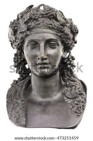Ancient bronze statue of Dionysus isolated on a white background. Dionysus is the Olympian God of the grape harvest, wine and merriment. He was also known as Bacchus.