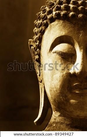 Ancient Buddha face - stock photo