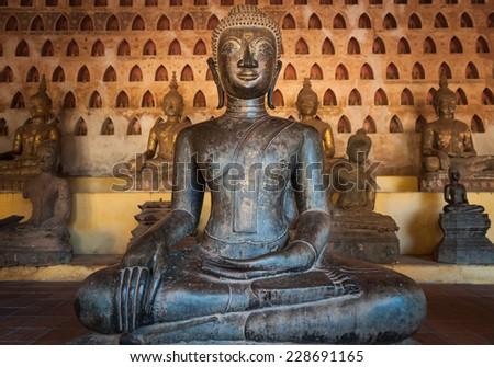 Ancient Buddha in Vientiane, Laos - stock photo