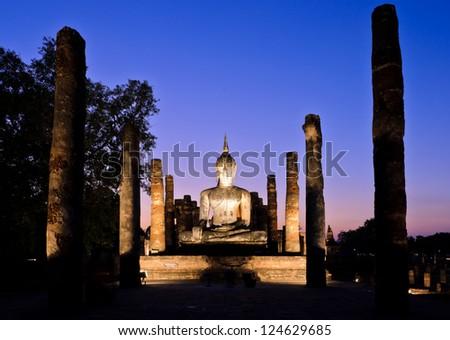 Ancient buddha statue at twilight, Wat Mahathat in Sukhothai His - stock photo