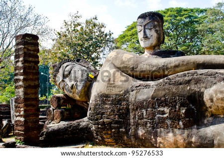 Ancient buddha statue in historical park, Kamphaengphet province, Thailand. - stock photo