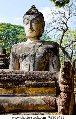 Ancient buddha statue in historical park, Kamphaengphet province, Thailand.