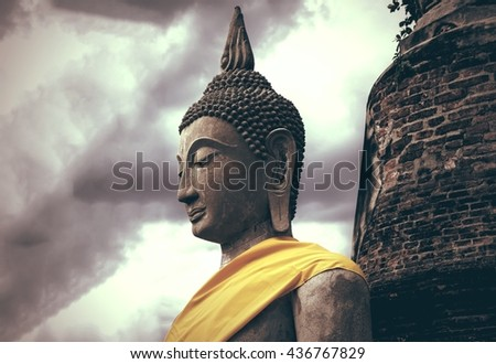 Ancient buddha statue with old pagoda  - stock photo