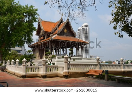 Ancient Buddhist gazebo on the background of a skyscraper. Bangkok, Thailand - stock photo