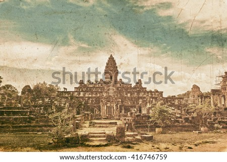 Ancient buddhist khmer temple in Angkor Wat complex in grunge and retro style, Cambodia - stock photo