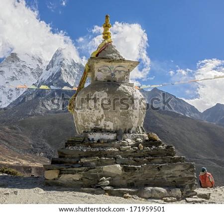 Ancient Buddhist stupa near Dingboche valley - Everest region, Nepal, Himalayas - stock photo