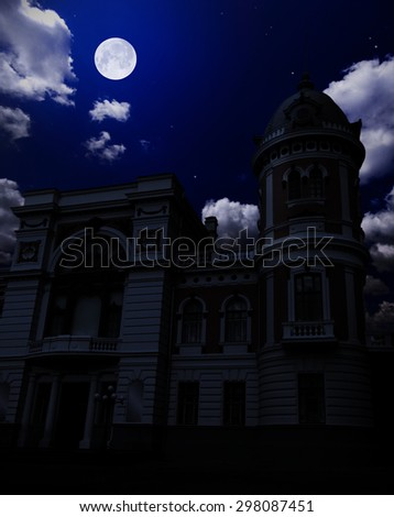 Ancient building under night sky with moon - stock photo