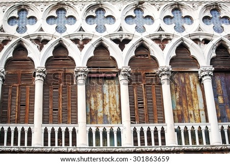 Ancient building with worn facade in Venice, Italy - stock photo