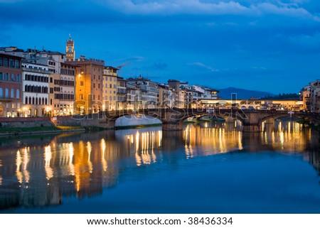 Ancient buildings and old bridge reflecting in River Arno in Florence, Italy - stock photo