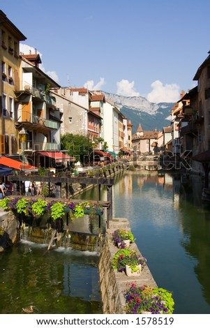 Ancient buildings near a river. Annecy, France - stock photo
