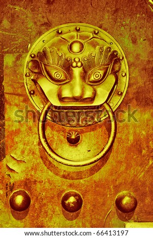 Ancient buildings on the east door knocker - stock photo