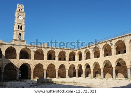 Ancient caravanserai in the city of Acre, Israel - stock photo