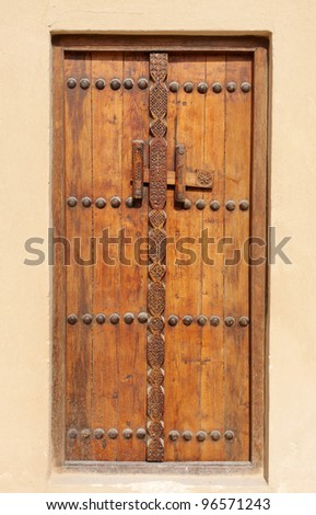 Ancient carved door in Riffa fort, Bahrain - stock photo