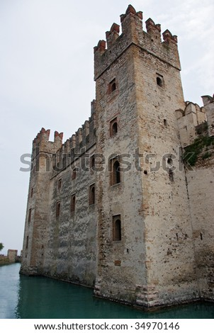 Ancient castle built next to the water of a lake - stock photo