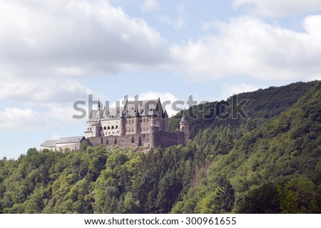ancient castle on green hill above the old town of vianden in luxemburg - stock photo