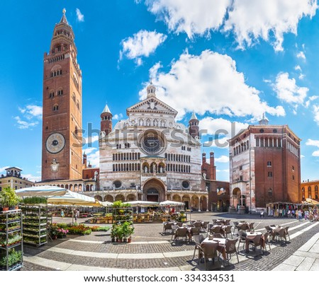 Ancient Cathedral of Cremona with famous Torrazzo bell tower and baptistery at beautiful market square Piazza Duomo in Cremona, Lombardy, Italy - stock photo