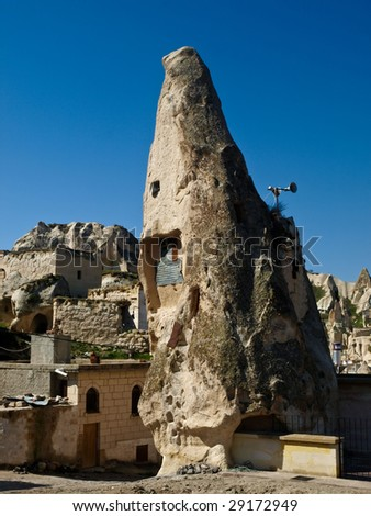Ancient cave houses in Goreme, Cappadocia, Turkey - stock photo