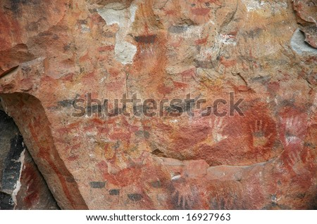 Ancient Cave Painting of Patagonia, with human hands and herds of guanaco (relative of the llama). - stock photo