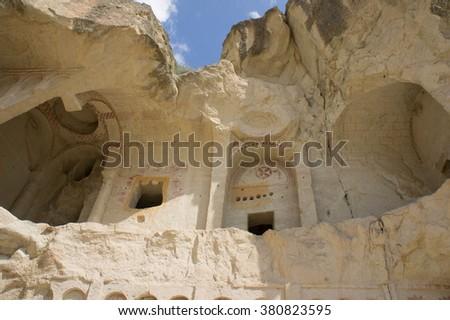 Ancient cavetown church near Goreme, Cappadocia, Turkey. Cappadocia mountain church. Goreme christian church. Christian church, Cappadocia, Turkey. Cave town with ancient christian church, Cappadocia. - stock photo