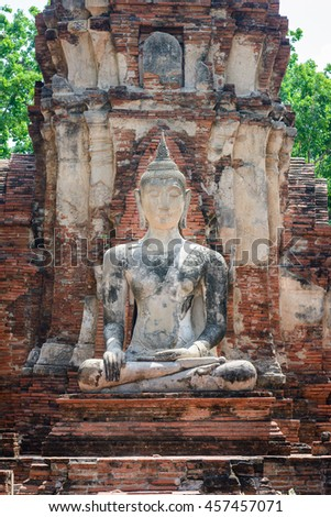 Ancient cement buddha statue at ruined ancient temple in world heritage city of Ayutthaya, Thailand - stock photo