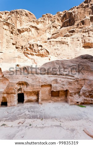 ancient chambers in caves in Little Petra, Jordan - stock photo
