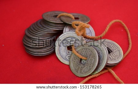 ancient chinese coins for sale in a native  ancient market in chiang mai, thailand - stock photo