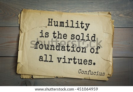Ancient chinese philosopher Confucius quote on old paper background. Humility is the solid foundation of all virtues. - stock photo