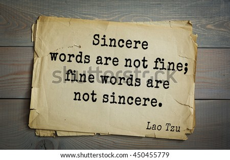 Ancient chinese philosopher Lao Tzu quote on old paper background. Sincere words are not fine; fine words are not sincere. - stock photo