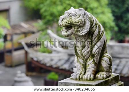 Ancient Chinese Stone tiger. Located in Dayong Fu, Zhangjiajie City, Hunan province, China. - stock photo