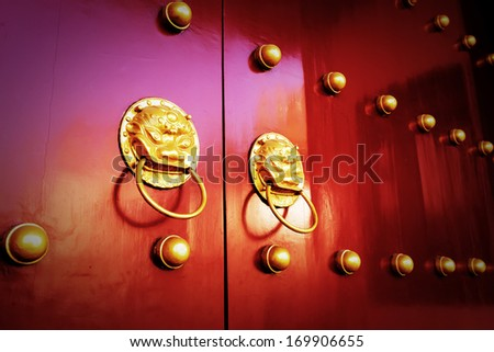 Ancient Chinese style red door. - stock photo