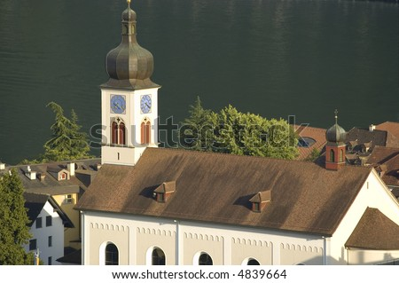 Ancient church by the lake in the sunset - stock photo