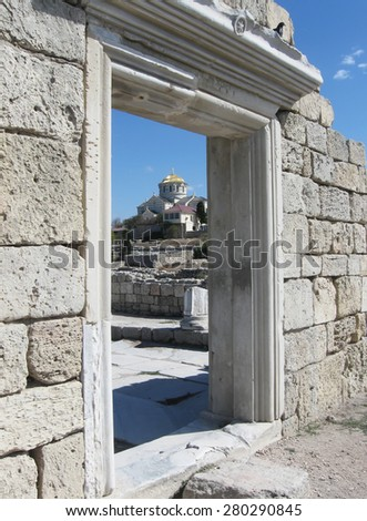 Ancient city Chersonesos Tauric,wall of famous Basilica, look through doorway on St. Vladimir's Cathedral in background,Sevastopol, Crimea, Russia.