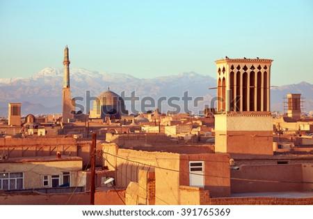 Ancient city of Yazd in sunrise lights. Iran - stock photo