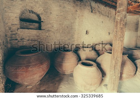 Ancient clay large barrels for wine.Chinese wine barrels - stock photo
