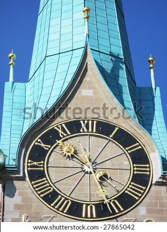Ancient clock on the top of Fraumuenster church in Zurich - stock photo