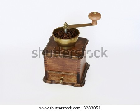 Ancient coffee grinder on white background