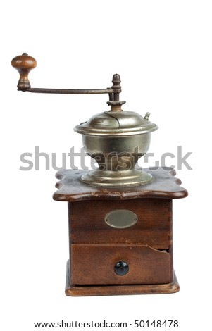 Ancient coffee mill isolated over white background