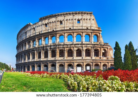 ancient Colosseum with flowers in Rome, Italy